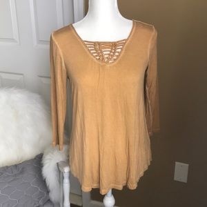 Beautiful washed out look mustard-colored top